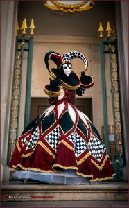 Yes, she may look like a 16th century Harley Quinn. But jesters are common in Venetian Carnival celebrations.