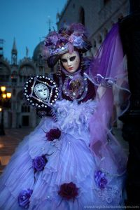 Here we see her with a purple parasol and hat along with an ornate mask mirror. All in all, I think this is try gorgeous.