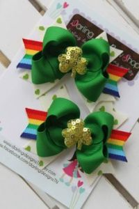 Consists of green bows with sequin gold shamrocks and rainbows. What more can an Irish girl want?