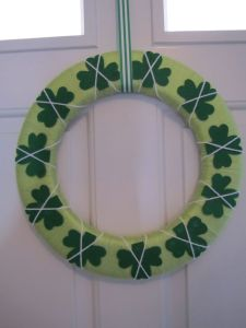 The shamrocks are made of felt and are tied down with yarn. At any rate, consider yourself lucky to have a decoration like this. Supposing you do.