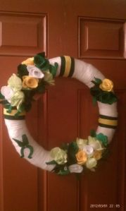 This one has green, white, and yellow flowers to match as well as a horseshoe. Lovely.