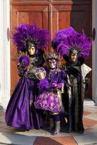 After all, these 3 are dressed in similar garb. And are wearing similar masks. Love how they're decked in purple.