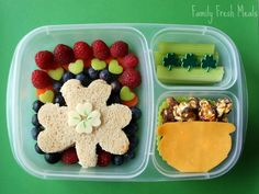 Includes a pot of gold with Cracker Jacks, a shamrock sandwich, and some celery. The fruit makes up the rainbow.