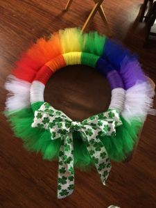 Has all the colors as well as white for cloud and some extra green. And it's all tied in a shamrock bow.