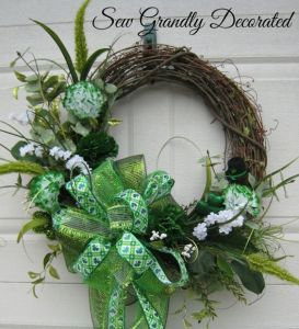 Another one with fake green flowers along with green ribbons. Wouldn't mind having this on my front door.
