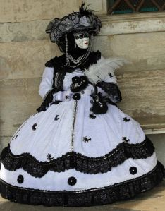 Well, this is a lovey dress. Like the hat that goes with it. Seems like she has a fancy feather accessory.