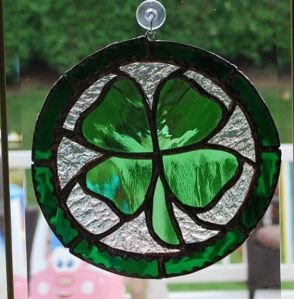Contains a stained glass 4-leaf clover for the sun to shine through. Love it.