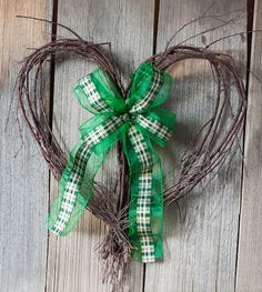 This one only entails a heart shaped wreath and a green ribbon. Great to put in any home.
