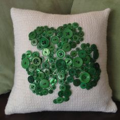 The shamrock here is made of buttons of all sizes. Love it.