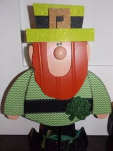 Another wooden leprechaun. Then again, this one has more of a body. But his hat is definitely one you can see for miles.