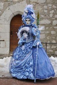 Even her fan has some semblance of winter. Lovely dress and mask.