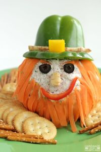 I don't know about you. But this leprechaun looks kind of mean to me. Though nice how they used carrot shavings for a beard and a green pepper hat.
