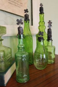 Not sure how to make the shamrock tops. But whoever did certainly has some interesting green bottles.