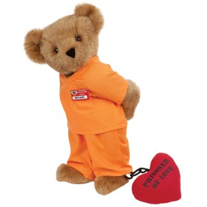 Comes with a heart and chain. Of course, this bear has to wear bright orange as modern prisoners do.