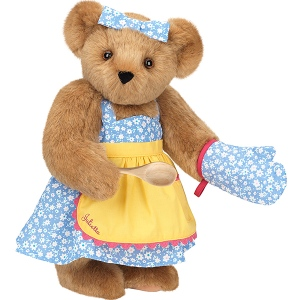 Of course, her dress always has to match her oven mitt. And she can'd do without her wooden spoon.