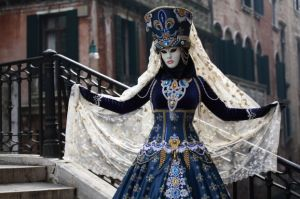 Well, this is quite stunning. Love the peacock blue dress. But the headdress really makes the costume.