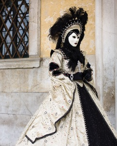 Well, the creamy white really goes with the black. Love the feather headdress.