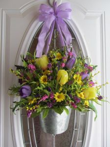 Well, it doesn't just have tulips. And the flowers are fake. But it'll certainly give a spring touch. Love the lavender ribbon.