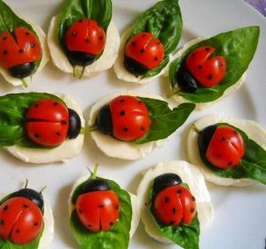 The ladybugs are made from olives and cherry tomatoes. Above all, these are cute.