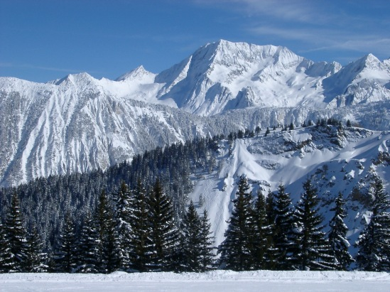 Steep Alpine mountains covered in winter snow