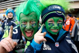 Seattle Seahawks fan and his son pose pose outside the stadium before the start of the NFL Super Bowl XLVIII football game in East Rutherford
