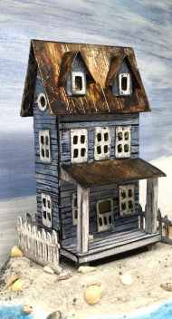 sea-worn-beach-house-putz-house-on-sandy-beach
