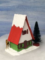 Side-Swiss-Chalet-Christmas-Putz-house-with-deer-peeking-around-corner