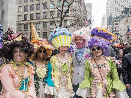 100571569-new-york-ny-usa-april-1-2018-unidentified-people-in-costumes-attend-2018-new-york-easter-parade-and-